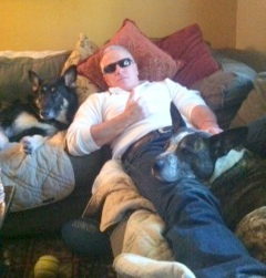 Former Congressdog Mick Cody (foreground) relaxes with his master (center) and life partner, Rooney (right).