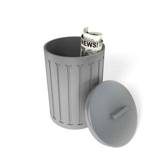November 10 - newspaper-in-trash-can