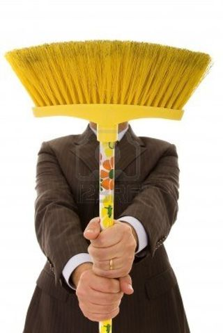 4496133-businessman-holding-a-cleaning-broom-selective-focus